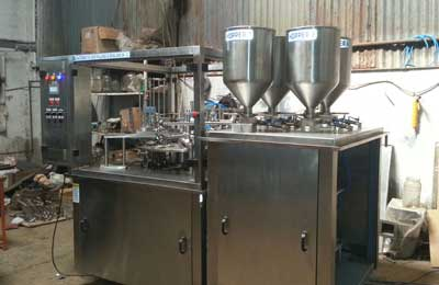 automatic-rotary-2-head-cup-filling-foil-sealing-machine