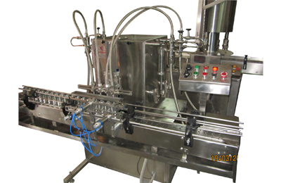 Automatic-Four-Head-Volumetric-Free-Flow-Liquid-Filling-Machines